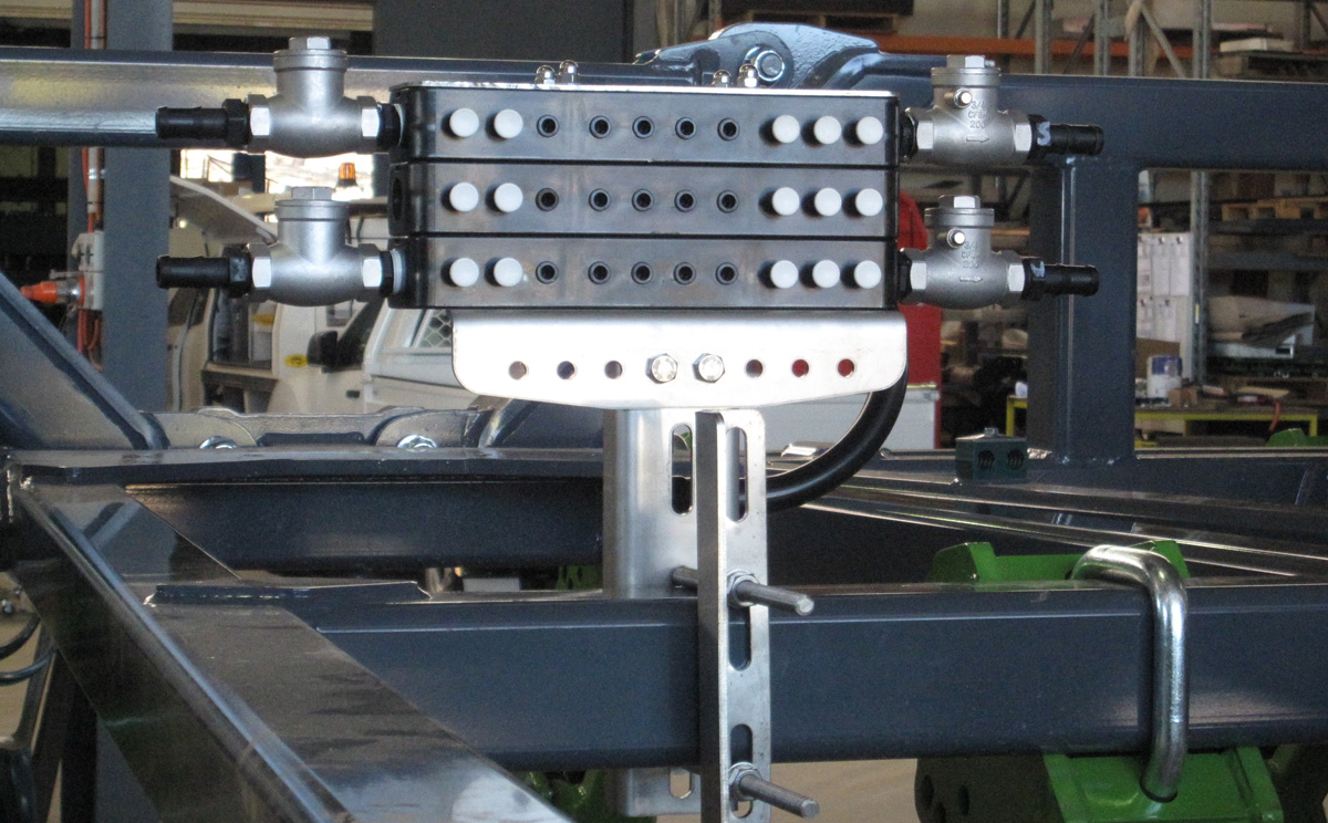 Dual Stacker Manifold with 1 x 50:50 half system shut-off mounted onto a Boss AG Strip Till Bar